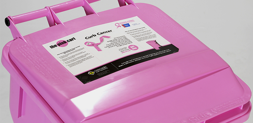 In-Mold Labeling Example on Pink Cart Lid - Cascade Cart Solutions